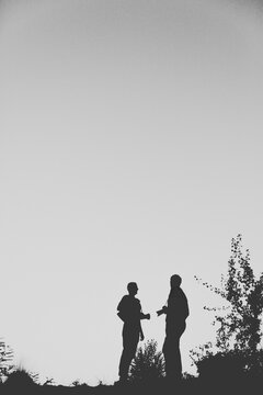 Silhouette Of Two Photographers