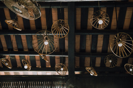 Low Angle View Of Antique Fans Hanging From Ceiling. Southeast Asia. Vietnam.