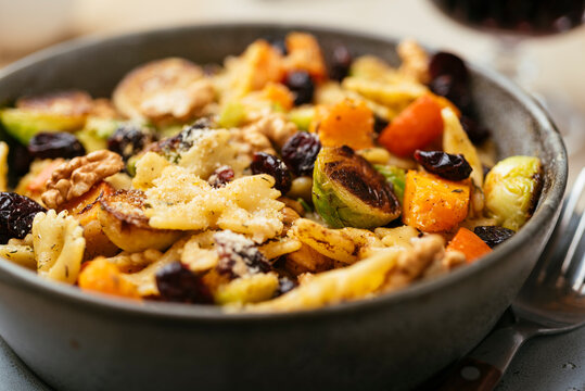 Brussels sprouts and winter squash on pasta with cranberries
