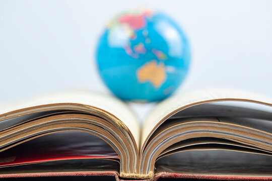 Opened book and world,  Education concept