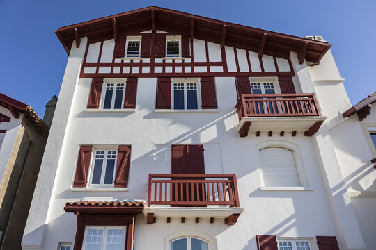 Traditional red and white Basque houses - typical architecture of Saint Jean de Luz, Pyrenees-Atlantiques department in southwestern France.