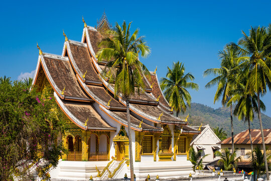 Exterior of Haw Pha Bang Buddhist temple against clear blue sky, Luang Prabang, Laos