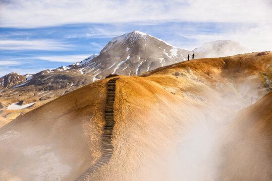 Travelers on mountain range in summer