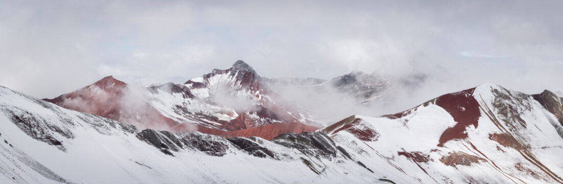 Panoramic view of snow covered Red Valley seen from Rainbow Mountain trail, Pitumarca, Peru