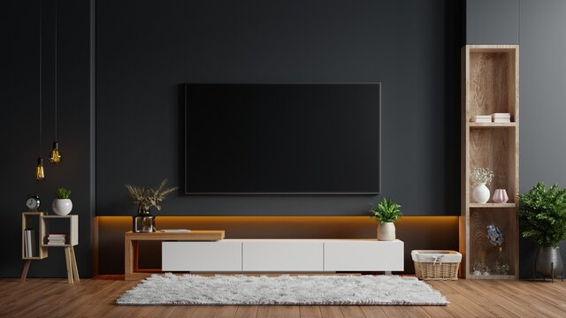 Mockup a TV wall mounted in a dark room with a black wall.