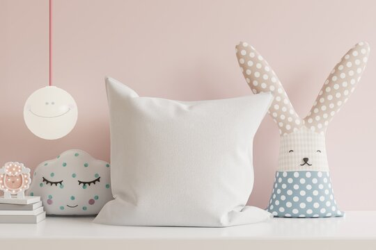 Mockup pillow in the children's room on light pink colors wall background.
