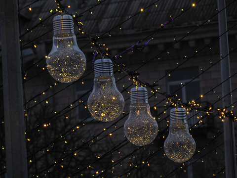 New Year's festive light decoration in the form of a large incandescent lamp