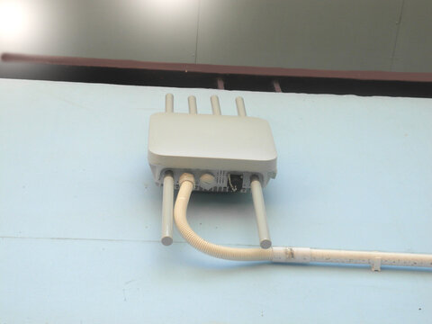 Outdoor wireless access point next to the building Wifi extender, Wireless Router Wi-Fi Access Point, internet transmitter