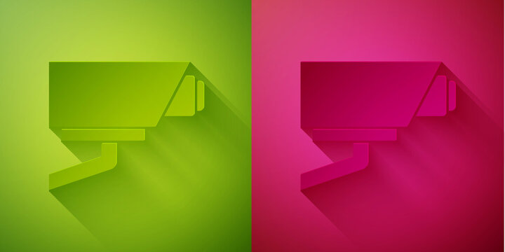 Paper cut Security camera icon isolated on green and pink background. Paper art style. Vector.