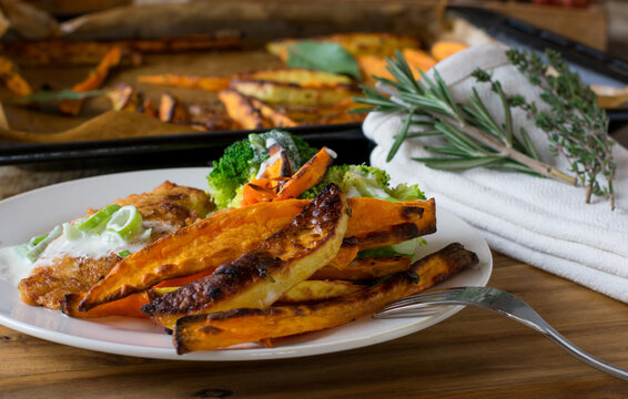 Sweet potato fries served as a side dish on a dinner plate