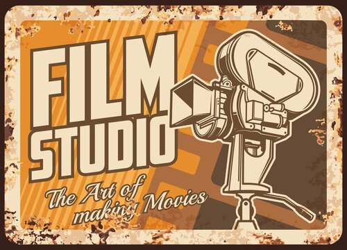 Film studio rusty metal plate, cinema or movie festival vector rust tin sign. Vintage video camera with film reels retro poster. Cinematography entertainment industry ferruginous card, old camcorder