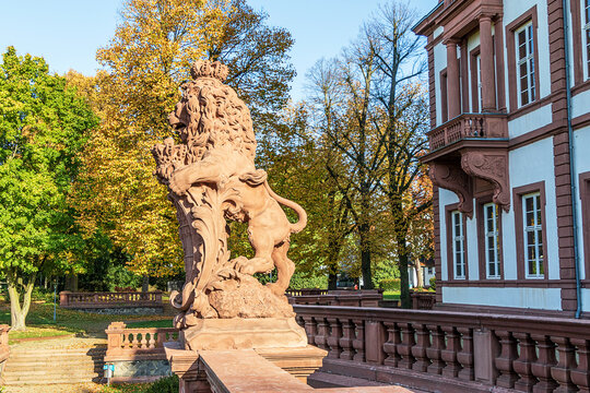 Lion sculpture in English landscaped park of Phillipsruhe Castle on a sunny October day in Hanau, Hesse, Germany