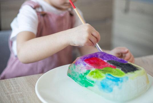 Child painting an ice, sensory activity, DIY.