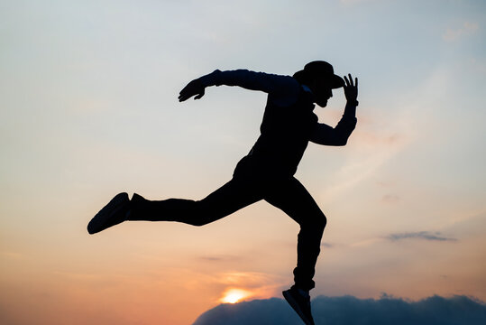 Let freedom ring. stamina and energy. need the inspiration. man feel motivation. challenge to himself. man runner silhouette on sky background. confidence and success. run to successful future