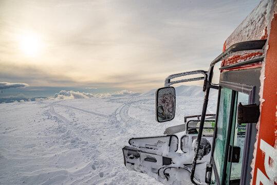 Snowcat at the winter mountains. Carpathian, Ukraine