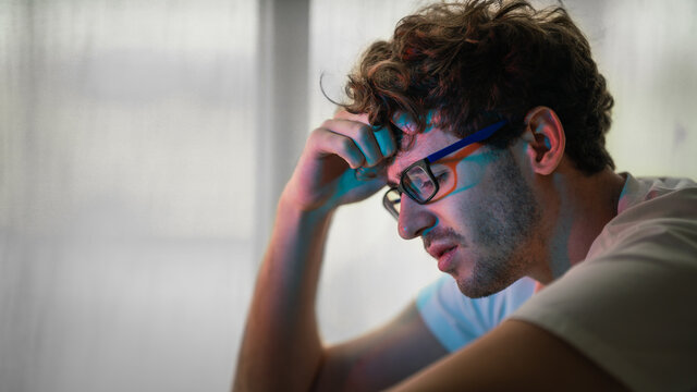 man sitting alone with desperate feeing and depressed from unemployment