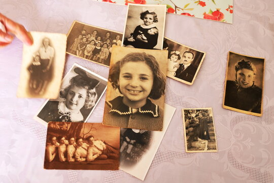 A collection of Holocaust survivor Leah Nebenzahl's family photographs are seen on a table during her interview with Reuters in Jerusalem