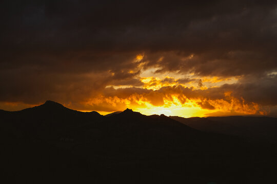 Fiery sunset in the mountains. Beautiful light from the sun.
