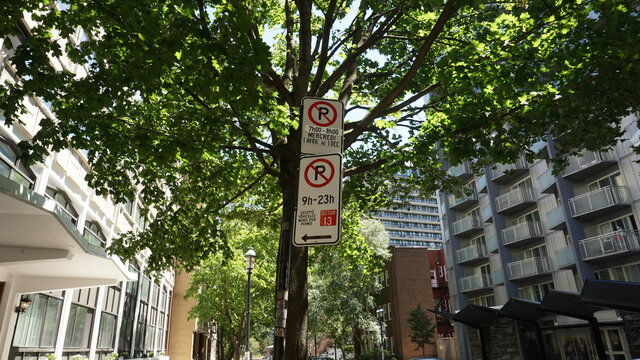 Montreal, QC- Canada - 6-24-2020: Parking challenge in downtown. No Parking signs: top (Wednesdays from 7:00 to 8:00 AM, from Apr 1st to Dec 1st), bottom (9:00 AM to 11:00 PM except for sector 13)