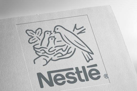 NESTLE logo on textured paper