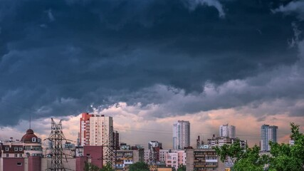 Fotobehang - Storm cloud passing over dramatic city skyline at dusk. Timelapse, 4K UHD.