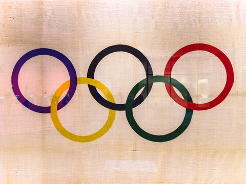 tokyo, japan - january 15 2020: Official olympic flag adorned with the  five-ringed symbol of the Olympic Games used during the Tokyo 1964 Summer Olympics games exhibited in the Japan Olympic Museum.