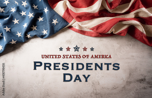 Happy presidents day concept with vintage flag of the United States on old stone background.
