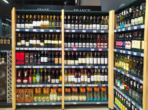 Assortment of alcoholic beverages in a popular wine shop