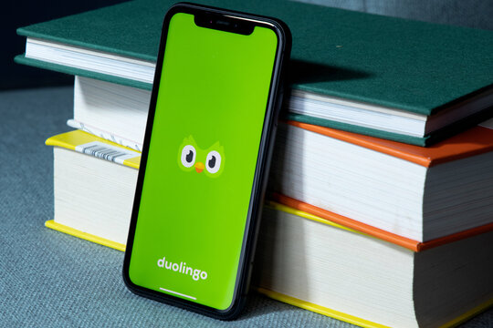 Duolingo app displayed on smart phone. Duolingo is an American language-learning website and mobile app, as well as a digital language-proficiency assessment exam.