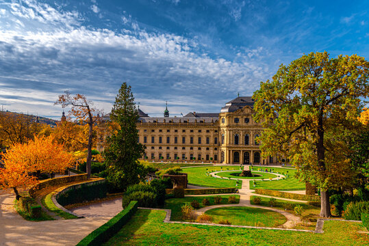 The Wurzburg Residence building and formal garden with flowers in Wurzburg, Germany