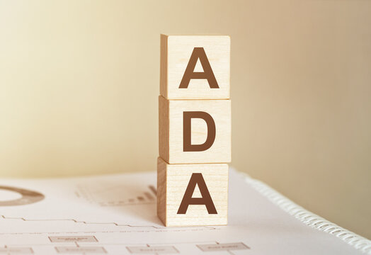 Word ADA made with wood building blocks