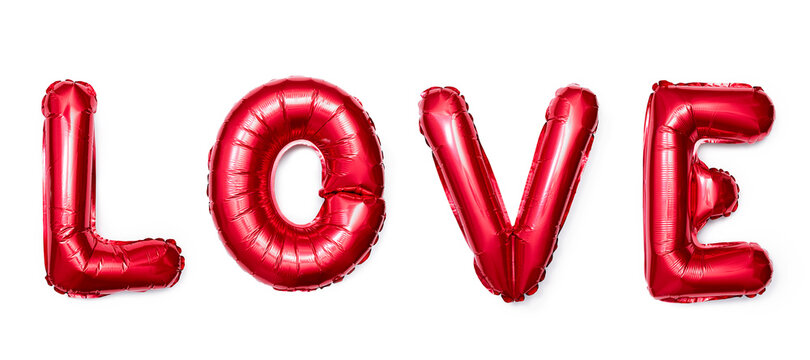 The inscription LOVE made of red balloons on a white background.
