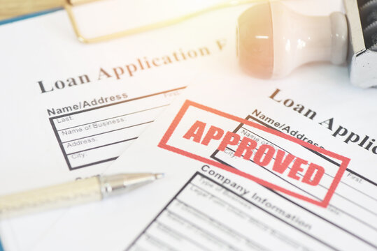 Loan application form with Rubber stamping that says Loan Approved, Financial loan money contract agreement company credit or person loan approval