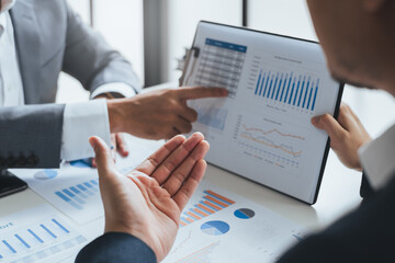 Obraz Businessman meeting and working with financial report, talking about business plan for investment, finance analysis concept - fototapety do salonu