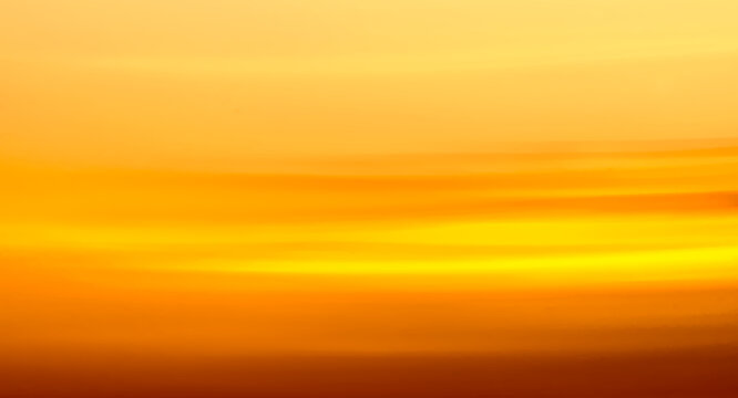 painterly abstract photography of orange sunset clouds