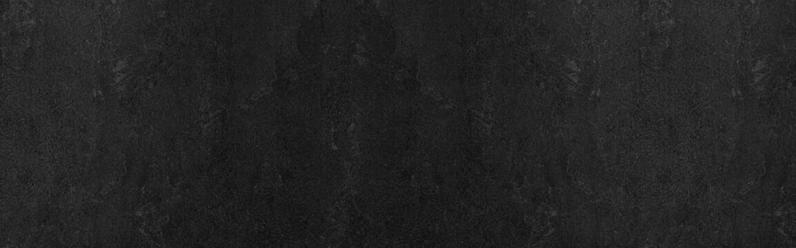 Panorama of Dark grey black slate background or texture. Black granite slabs background