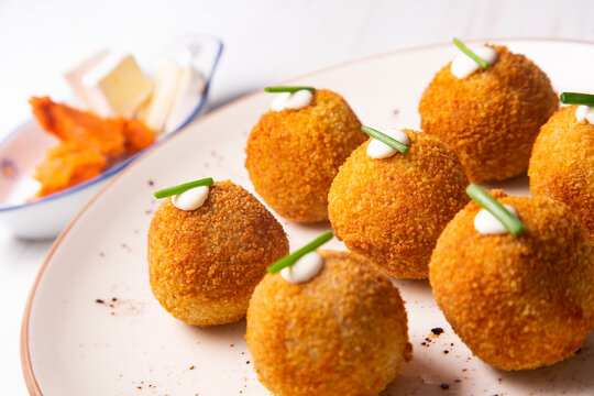 Traditional spanish croquettes from mallorca with sobrassada and cheese