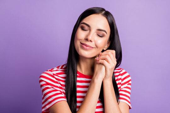 Photo of dreamy peaceful young woman imagine girl hands together closed eyes isolated on violet color background