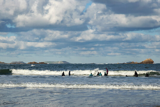 Stroll  in the sea along the coast in a wetsuit