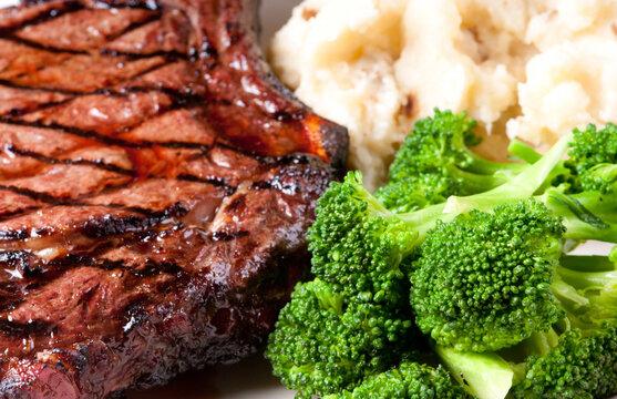 bbq rib steak with garlic mashed potatoes brocolli