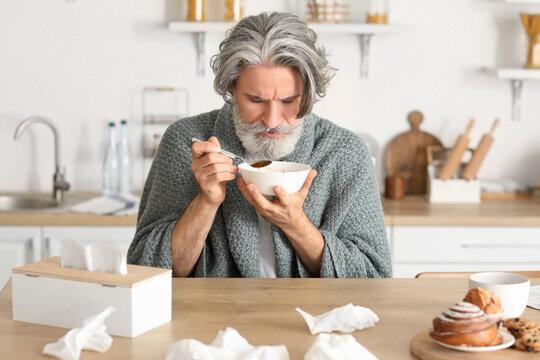 Sick mature man at home