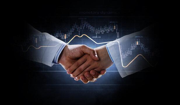 Partnership concept. Image of handshake