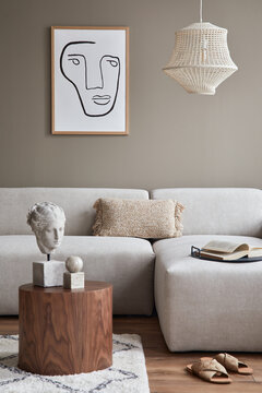 Stylish interior with design neutral modular sofa, mock up poster frames, coffee tables, wooden tray, book, decoration, slippers and elegant personal accessories in modern home decor. Template.