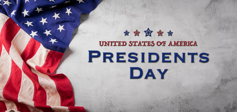 Happy presidents day concept with flag of the United States on old stone background.