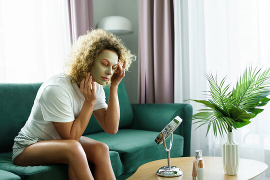 Beautiful woman is applying exfoliating and  cleansing mask