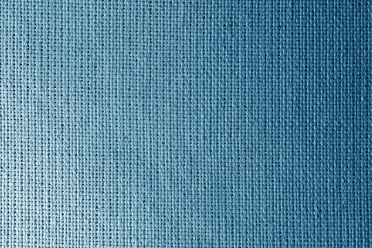 Shiny blue fabric texture. Blue fabric background with light and dark areas