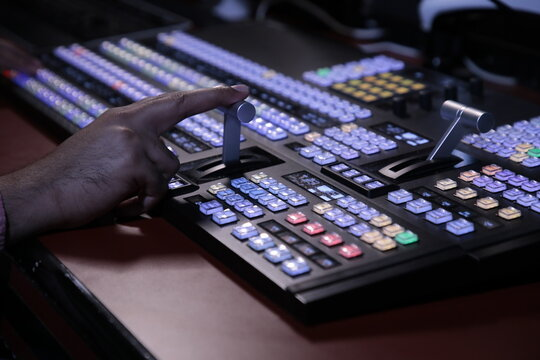Hand operating video production switcher, television, audio visual, av, buttons