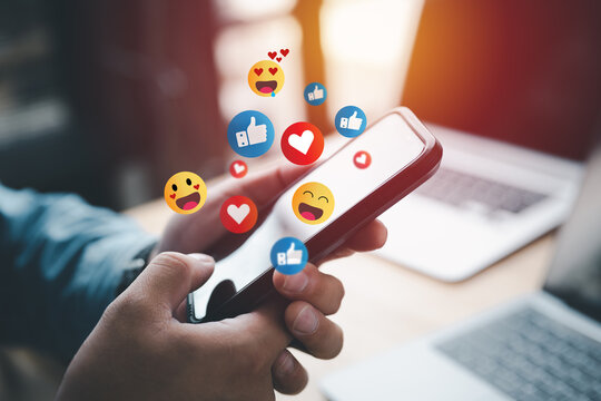 Social media and digital online concept, man using smart phone with Social media. The concept of living on vacation and playing social media. Social Distancing ,Working From Home concept.