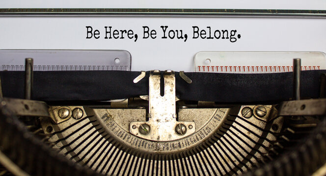 Inclusion and belonging symbol. Words 'be here, be you, belong' typed on retro typewriter. Business, inclusion, belonging and you belong here concept. Beautiful background.