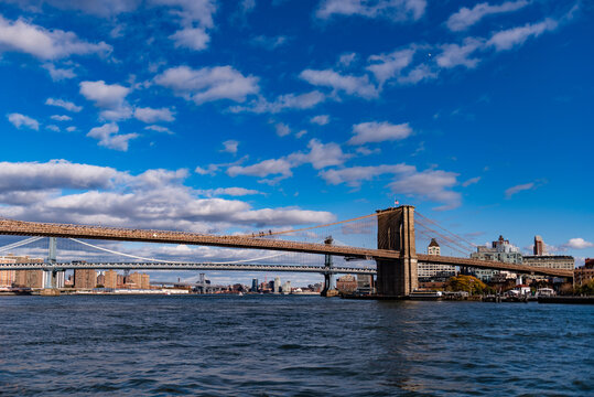 The Brooklyn and Manhattan Bridge are seen in a sunny day.